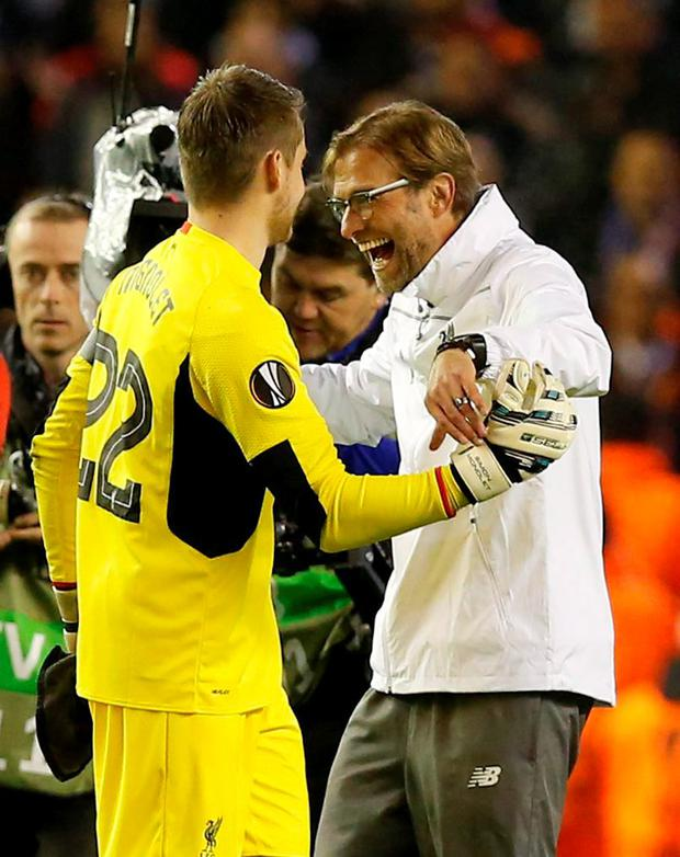 Liverpool manager Juergen Klopp and Simon Mignolet celebrate at the end of the match Reuters / Andrew Yates Livepic EDITORIAL USE ONLY.