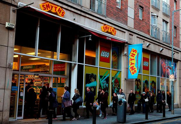A queue forms outside Smyths Toy store in Dublin city centre, as retailers open their doors early to a relatively slow start on Black Friday. Brian Lawless/PA Wire