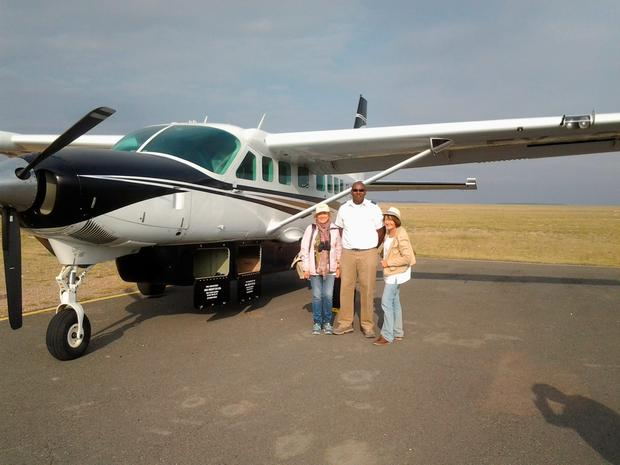 Isabel with Peter the pilot and their Sky Safari plane in Kenya.