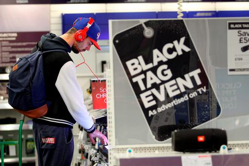 Customers at Currys PC World take advantage of the Black Friday deals at their Tottenham Court Road store in London. Gretel Ensignia/PA Wire