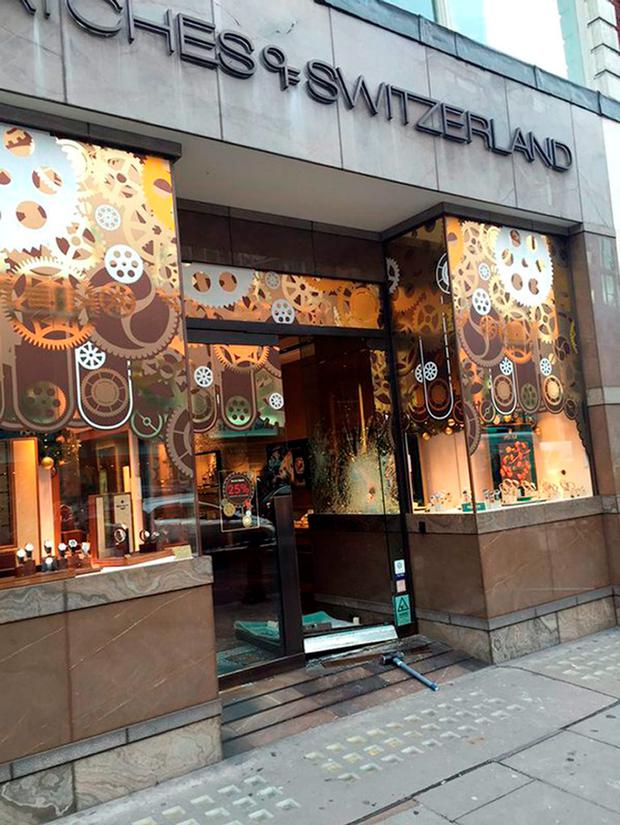 Photo taken with permission from the Twitter account of @mylozane showing the damage caused to a Watches of Switzerland store in Kensington following a smash and grab raid Credit: Christophe Leyvraz /PA Wire