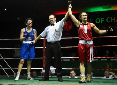 27 November 2015; Katie Taylor, Bray Boxing Club, is declared the winner over Shauna O'Keefe, Clonmel Boxing Club, at the end of their 60kg bout. IABA National Elite Female Championship Finals. National Stadium, Dublin. Picture credit: David Maher / SPORTSFILE