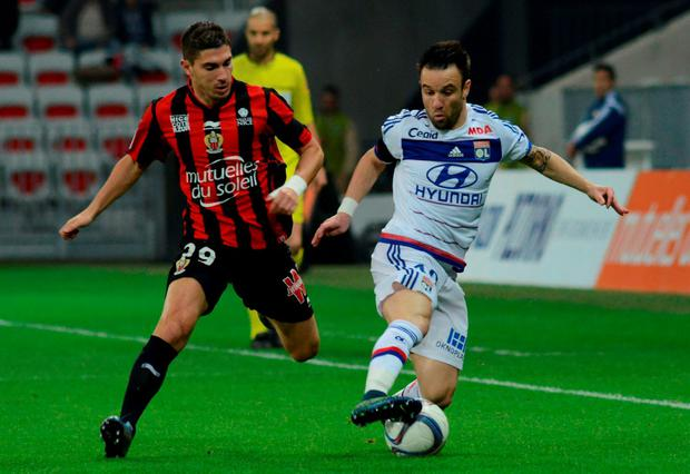 Olympique Lyon's Mathieu Valbuena, right, in action with Nice's Jeremy Pied during their French Ligue 1 soccer match at Allianz Riviera stadium in Nice