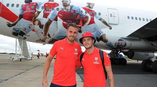 Aaron Ramsey and Jack Wilshere took this plane for a pre-season tour of Singapore - but do Arsenal need one to go to Norwich?