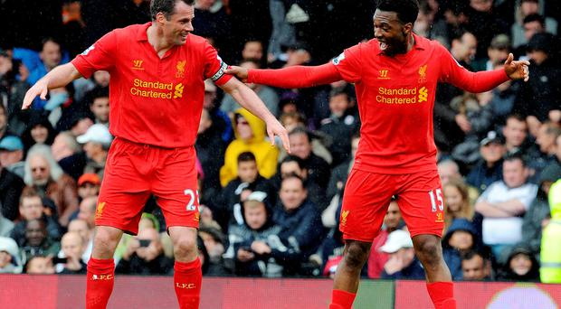 Daniel Sturridge of Liverpool with Jamie Carragher