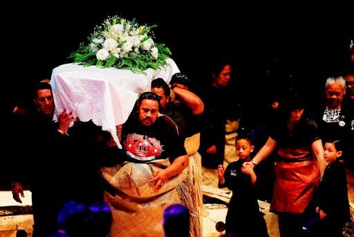 TOPSHOTS The casket containing the body of Jonah Lomu is carried out by his family members after the Aho Faka Famili memorial for Lomu at the Vodafone Events Centre in Auckland on November 28, 2015. AFP PHOTO / POOL / HANNAH PETERSHANNAH PETERS/AFP/Getty Images