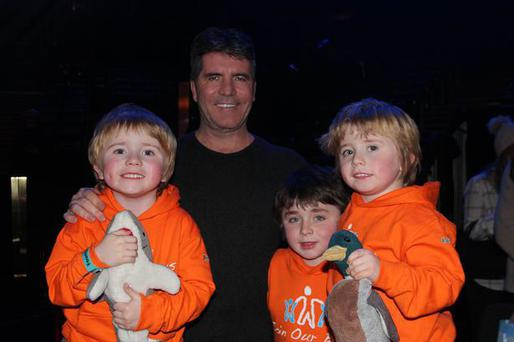 Simon Cowell with brothers Archie, George and Isaac Naughton. simoncowellnews.wordpress.com