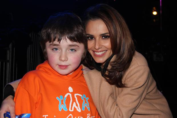 Archie Naughton poses with Cheryl Fernandez-Versini backstage at the X Factor studios. Facebook.