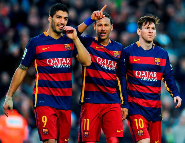 Neymar (C) of FC Barcelona celebrates with his teammates Luis Suarez (L) and Lionel Messi