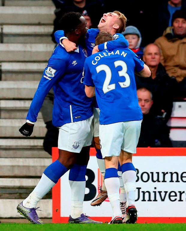 Romelu Lukaku (L) of Everton celebrates scoring his team's first goal with his team mates Gerard Deulofeu (C) and Seamus Coleman (R)