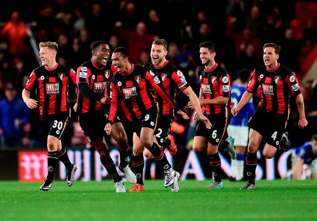 AFC Bournemouth's Junior Stanislas (no19) celebrates scoring the equalising goal