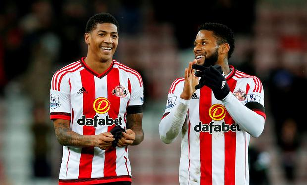 Sunderland's Patrick Van Aanholt and Jeremain Lens celebrate at the end of the match