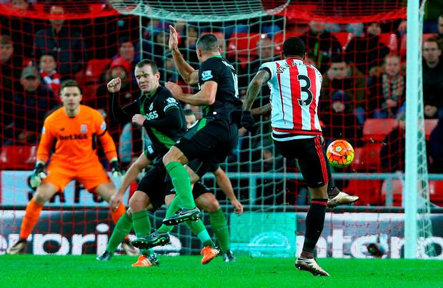 Patrick van Aanholt of Sunderland scores his team's first goal during the Barclays Premier League match between Sunderland and Stoke City