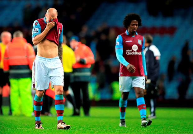 Aston Villa's Alan Hutton (left) and Aston Villa's Carlos Sanchez (right) leave the pitch dejected after the Barclays Premier League match at Villa Park, Birmingham. PRESS ASSOCIATION Photo. Picture date: Saturday November 28, 2015. See PA story SOCCER Villa. Photo credit should read: Nick Potts/PA Wire. RESTRICTIONS: EDITORIAL USE ONLY No use with unauthorised audio, video, data, fixture lists, club/league logos or