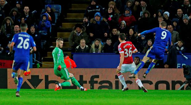 Jamie Vardy scores the first goal for Leicester City to break the record after scoring in eleven consecutive Premier League games