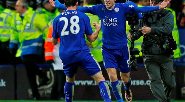 Jamie Vardy celebrates with Christian Fuchs scoring the first goal for Leicester City and breaking a record after scoring in eleven consecutive Premier League games