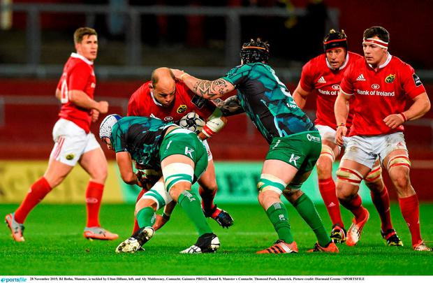 28 November 2015; BJ Botha, Munster, is tackled by Ultan Dillane, left, and Aly Muldowney, Connacht. Guinness PRO12, Round 8, Munster v Connacht. Thomond Park, Limerick. Picture credit: Diarmuid Greene / SPORTSFILE