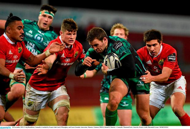 28 November 2015; Craig Ronaldson, Connacht, is tackled by Francis Saili, Jack O'Donoghue, and Lucas Gonzalez Amorosino, Munster. Guinness PRO12, Round 8, Munster v Connacht. Thomond Park, Limerick. Picture credit: Diarmuid Greene / SPORTSFILE