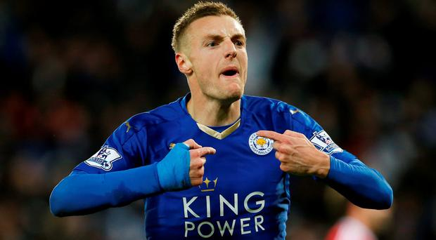 Jamie Vardy celebrates scoring the first goal for Leicester City and breaking a record after scoring in eleven consecutive Premier League games