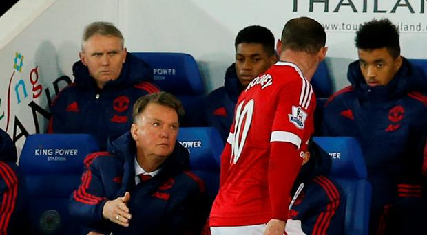 Wayne Rooney with Manchester United manager Louis van Gaal after he was substituted