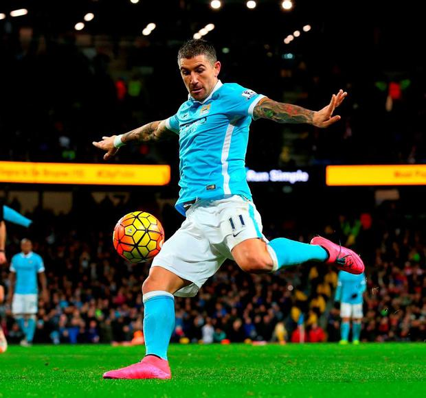 Aleksandar Kolarov scores Manchester City's third goal at the Etihad Stadium yesterday
