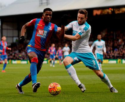 Newcastle's Paul Dummett in action with Crystal Palace's Wilfried Zaha