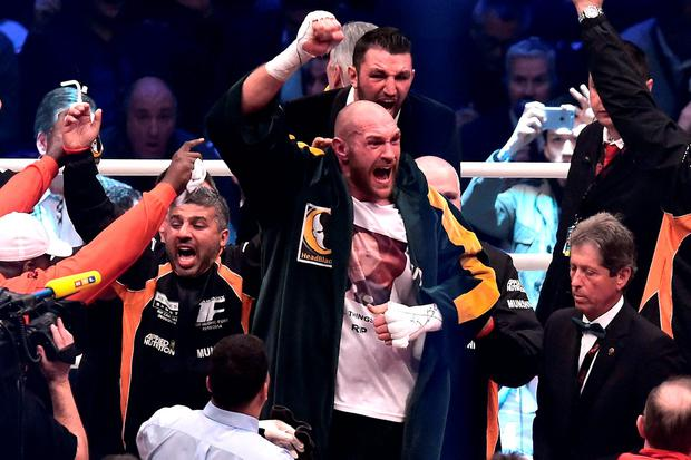 Tyson Fury (C) celebrates after winning his fight against Wladimir Klitschko at Esprit-Arena on November 28, 2015 in Duesseldorf, Germany. (Photo by Sascha Steinbach/Bongarts/Getty Images)