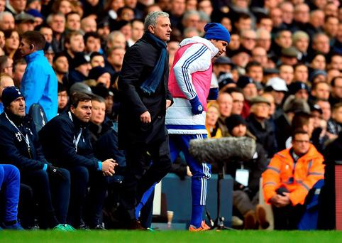 Chelsea striker Diego Costa passes manager Jose Mourinho as he goes to warm up at White Hart Lane.