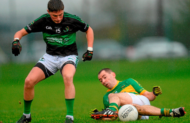 Colin O'Brien of Nemo Rangers in action against Fergal Condon of Clonmel Commercial in the AIB Munster GAA Senior Club Football Championship Final. Picture credit: Piaras Ó Mídheach / SPORTSFILE