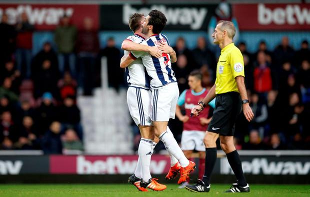 Rickie Lambert and Claudio Yacob celebrates after West Ham's Winston Reid scored an own goal