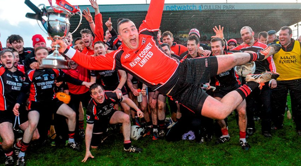 Ben O'Connor of Oulart the Ballagh, celebrates with his team-mates at the end of the game. Picture credit: David Maher / SPORTSFILE
