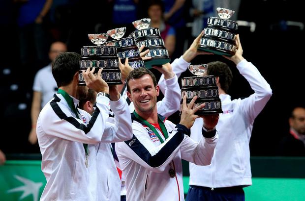 Great Britain's captain Leon Smith lifts a replica trophy during day three of the Davis Cup Final at the Flanders Expo Centre, Ghent.