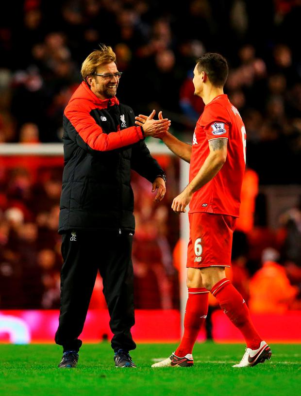 Jurgen Klopp manager of Liverpool and Dejan Lovren of Liverpool shake hands after the Barclays Premier League match between Liverpool and Swansea City at Anfield on November 29, 2015 in Liverpool, England. (Photo by Alex Livesey/Getty Images)