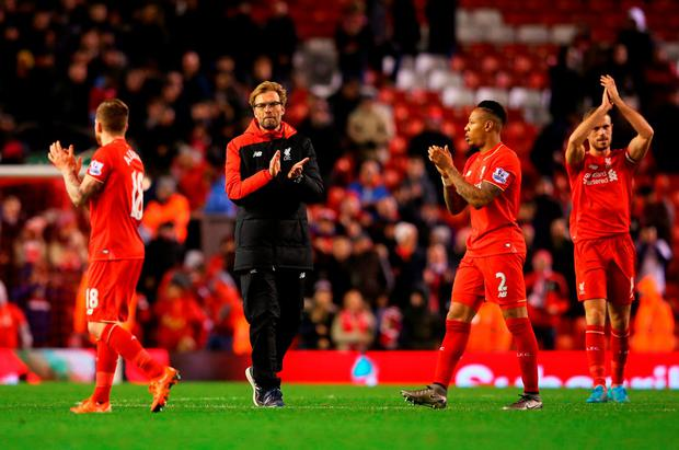 Jurgen Klopp manager of Liverpool and Nathaniel Clyne of Liverpool (2) applaud the crowd after the Barclays Premier League match between Liverpool and Swansea City at Anfield on November 29, 2015 in Liverpool, England. (Photo by Alex Livesey/Getty Images)