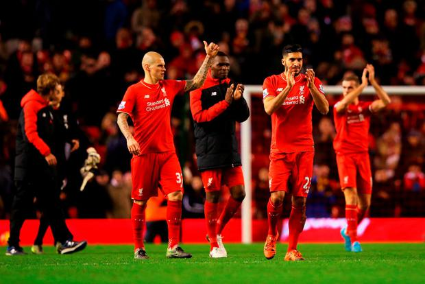Emre Can, Christian Benteke and Martin Skrtel of Liverpool applaud the crowd after the Barclays Premier League match between Liverpool and Swansea City at Anfield on November 29, 2015 in Liverpool, England. (Photo by Alex Livesey/Getty Images)