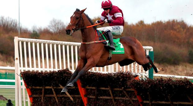 Identity Thief and Bryan Cooper on their way to victory in the Fighting Fifth Hurdle at Newcastle