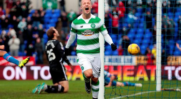 Leigh Griffiths celebrates after scoring the second goal for Celtic