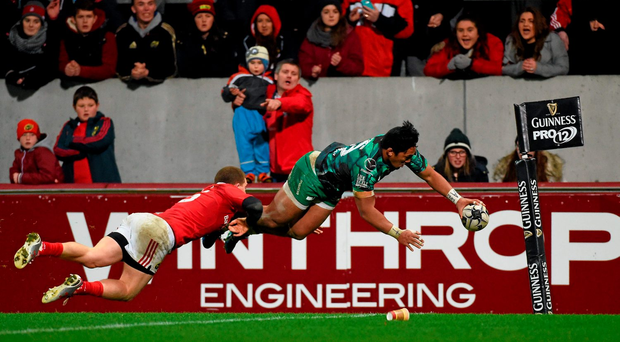 Bundee Aki scores Connacht's second try despite the efforts of Andrew Conway
