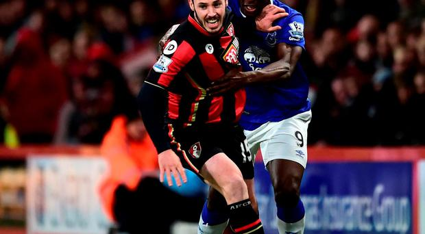 Bournemouth's Adam Smith (left) and Everton's Arouna Kone battle for possession during their Barclays Premier League match at Vitality Stadium