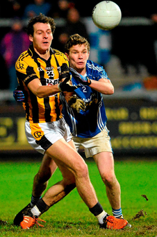 Crossmaglen's Jamie Clarke releases a pass under pressure from Scotstown's Damien McArdle, during their AIB Ulster Club SFC final