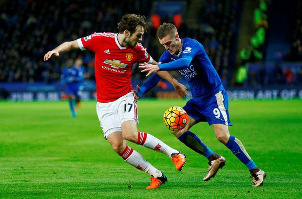 Manchester United's Daley Blind and Leicester City's Jamie Vardy battle for the bal