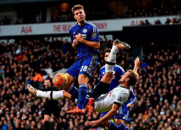 Tottenham striker Harry Kane attempts an overhead kick under pressure from Cesar Azpilicueta