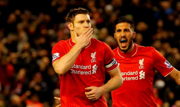 James Milner celebrate after scoring the winner