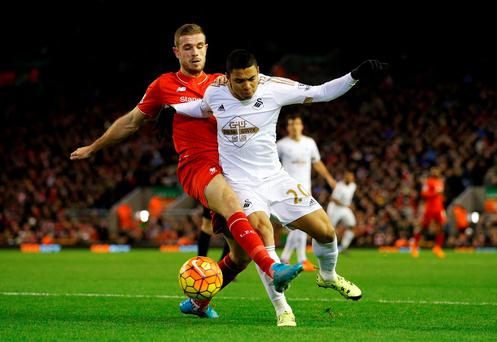 Swansea's Jefferson Montero challenges for the ball with Liverpool's Jordan Henderson Action Images via Reuters / Carl Recine