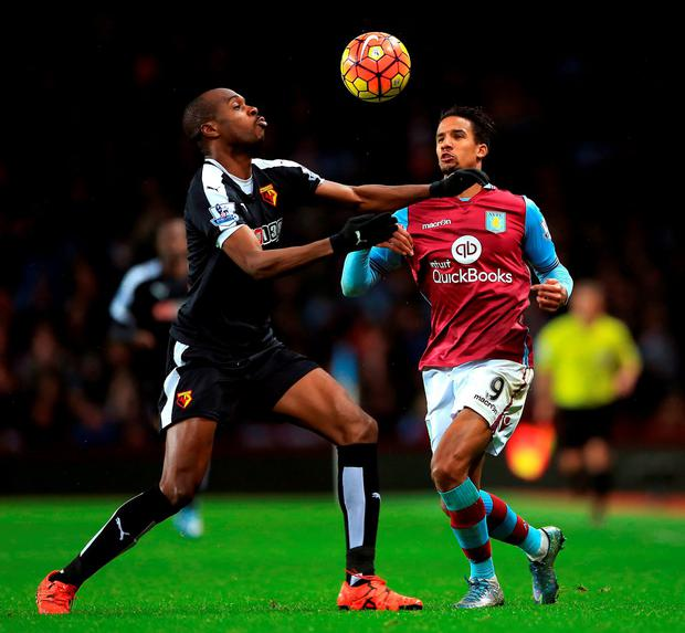 Watford's Allan-Romeo Nyom (left) and Aston Villa's Scott Sinclair battle for the ball during the Barclays Premier League match at Villa Park
