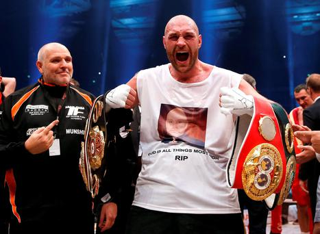 Tyson Fury celebrates after beating Wladimir Klitschko