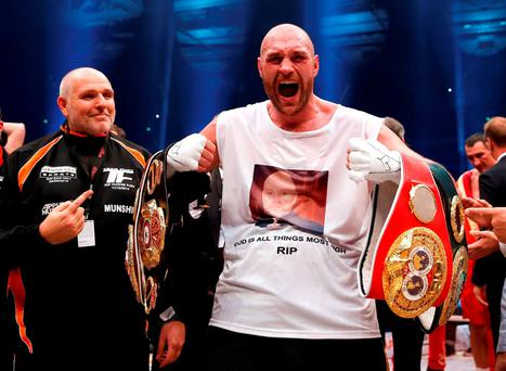 Tyson Fury celebrates after beating Wladimir Klitschko in Dusseldorf to claim the world heavyweight crown