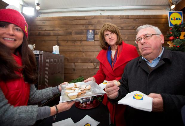 Tánaiste Joan Burton and Joe Costello TD enjoyed some Lidl mince pies at the IFSC Christmas Village yesterday