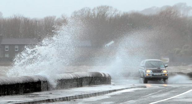 Storm-force wind slams the sea over the wall in Westport, Mayo