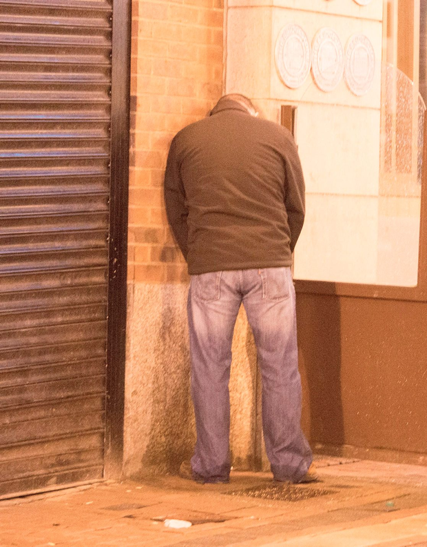 A man urinates outside a cafe in Limerick city